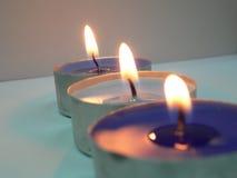 3 velas en una fila Imagen de archivo libre de regalías
