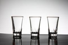3 vidrios vacíos con la luz Imagen de archivo