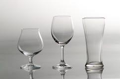 3 vidros vazios no estilo diferente Foto de Stock Royalty Free