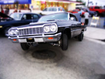 3 Wheel Motion. A Lowrider Car In 3 Wheel Motion, hitting the switches royalty free stock photo