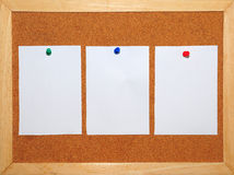 3 White Paper pinned on Corkboard Stock Images
