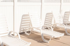 3 White Plastic Outdoor Lounge Chair on Brown Tiled Floor during Daytime Stock Photo