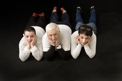 3 women lying down on the floor Stock Photos