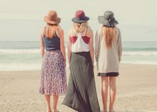 3 Women Standing Near Sea Under White Clouds during Daytime Royalty Free Stock Photography