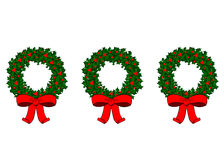 3 Wreaths. Of holly with red ribbons Stock Photography