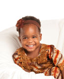 3 year old African American girl sit on bed Royalty Free Stock Photos