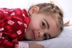 3 year old awaking. Little girl awaking in the morning after a good night sleep stock photo