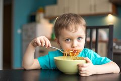 3 year old boy while eating Stock Photography