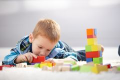 3 year old boy lost in playing Royalty Free Stock Photo