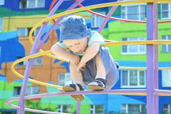 A 3-year-old boy on the stairs Stock Images