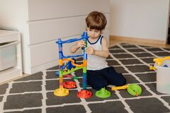 Free 3 Year Old Child Is Playing Alone. Autism And Misunderstandings. Concept Of Psychological Problems Stock Images - 219566144