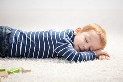 Free 3 Year Old Falling Asleep On Floor At Home Stock Images - 18040044