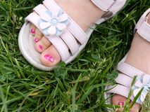 3 year old girl�s pedicure in white dress sandals Stock Photo