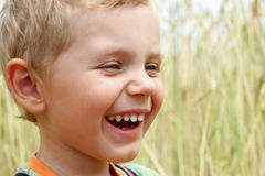 3 years old boy laughing Stock Photography