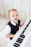 3-years pianist  play music Stock Image
