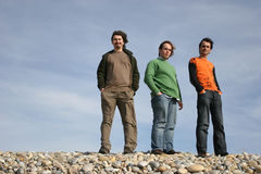 3 young men posing. At the beach stock image