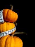 3 zucche con nastro adesivo di misurazione Immagine Stock Libera da Diritti