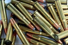 30-30 Caliber Shells. A bunch of 30-30 caliber shells on white background Royalty Free Stock Image