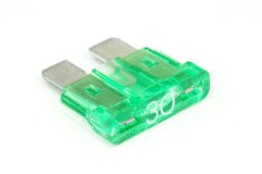 30-Amp blade fuse (green) on white Stock Image