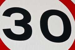 30 miles an hour speed limit sign. A close up crop of a 30 miles an hour speed limit sign Royalty Free Stock Images