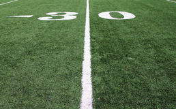 30 Yard Line. Sideline View of the 30 Yard Line on a Football Field Taken Close to the Ground Stock Photography