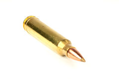 300 WM caliber cartridge on white background. Slanted front view 300 winchester magnum caliber cartridge on white background Stock Photography