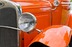 30s Car. Classic orange 30s car with front grill and headlamp Stock Images