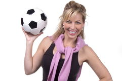 30s soccer mom. Happy mom in studio with soccer ball