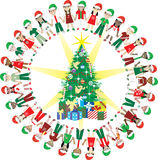32 Kids Love Christmas World 2. Kids Love Christmas World 2. 32 Different Children representing different countries around the Christmas Tree Stock Photo