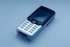 蓝色移动电话口气 库存图片