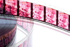 35 mm color film. 35 mm old film with audio track isolated in white background Stock Photos