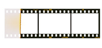 35 mm filmstrip, 3 picture frames,. 35 mm filmstrip, picture frames,isolated on white background, ensd of film with overexposure on left side Royalty Free Stock Photography