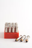 .357 Magnum. Tray of .357 magnum ammunition with three additional rounds next to it royalty free stock images