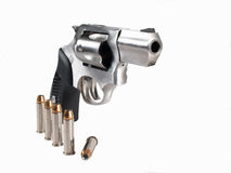 .357 Magnum Revolver with Bullets. High key photo of .357 magnum revolver with Bullets stock image