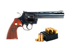 .357 revolver with ammo, isolated. Royalty Free Stock Photos