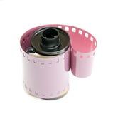 35mm影片罐和被盘绕的负的 免版税库存图片
