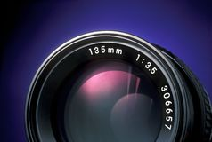 35mm camera lens with a focal length of 135mm. A 35mm camera lens with a focal length of 135mm Royalty Free Stock Photos