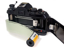 35mm film camera. A 35mm film camera with the back open and a roll of analog film ready to be loaded Royalty Free Stock Photography