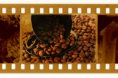 35mm film with cup and grain of coffee. Vintage 35mm film with cup and grain of coffee Stock Photo
