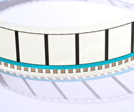 35mm film projection. Blank frames of 35mm film projection on a white background stock photo