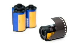 35mm Film Roll With Blurrer Rols In The Background Stock Image