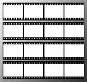 35mm film strip frame frames. 35mm film strip showing 16 black frames which could be used as a story board on a grey graduated background Stock Photography