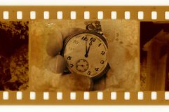 35mm frame photo with vintage clock. Old 35mm frame photo with vintage clock in hand stock photo