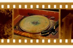 35mm frame photo with vintage gramophone. Old 35mm frame photo with vintage gramophone Royalty Free Stock Photography