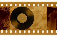 35mm frame photo with vintage vinyl disk Royalty Free Stock Image