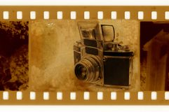35mm frame with vintage photo camera. Old 35mm frame with vintage photo camera stock image