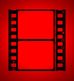 35mm movie Film in red light Royalty Free Stock Photo