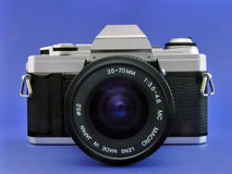 35mm slr camera. 35mm sler camera on blue Royalty Free Stock Images