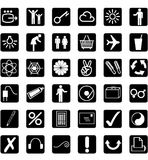 36 different icons - white - background black Stock Photography