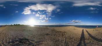 360 degree beach panorama. Full 360 degree panorama of a beach on a peninsula on a sunny afternoon. Complete with puffy white clouds and blue sky Royalty Free Stock Photos